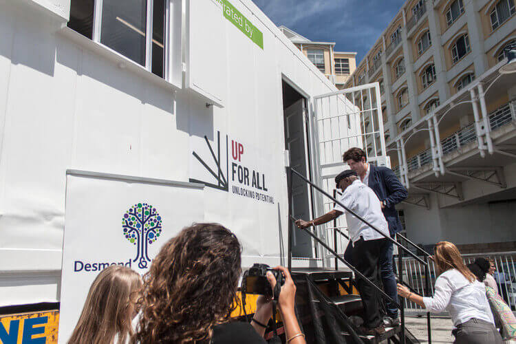 Bishop Desmond Tutu Getting Into A Container   Container Rental & Sales