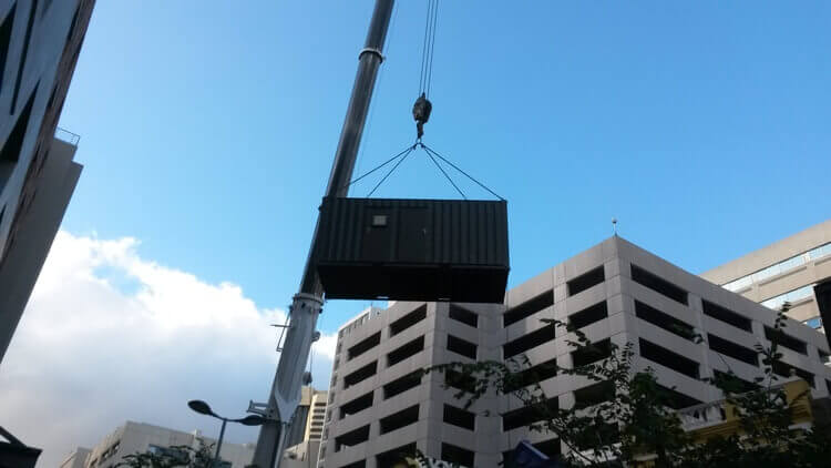 Container Going Over Building   Container Rental & Sales 010