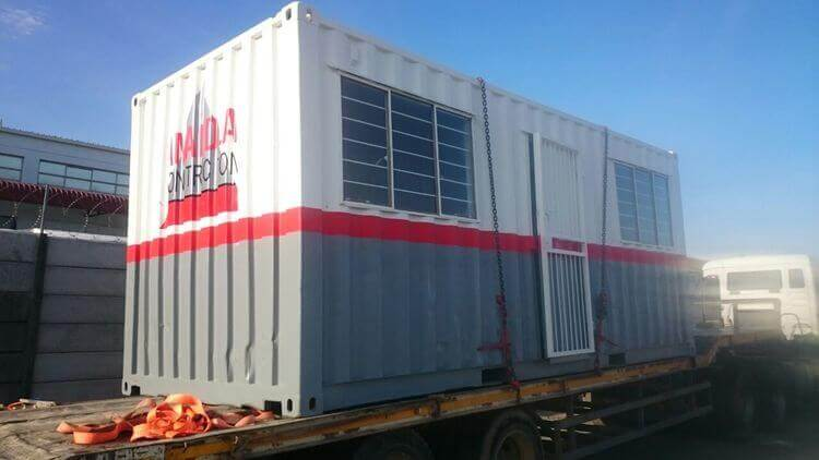 Grey And White Shipping Container On A Truck | Container Rental & Sales